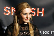Abigail Breslin wore her tresses partially drawn back at the premiere of 'Smash.'