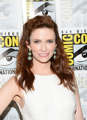 Bitsie pulled back her pretty waves into a half updo for a classic look.