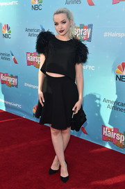 Dove Cameron matched her top with a pleated black mini skirt, also by Co.