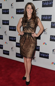 Sara Bareilles looked chic in a brocade dress with a black pleated overlay for the 'Sing Off' finale.