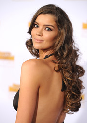 Natasha Barnard wore her hair long and curly at the Sports Illustrated Swimsuit Issue 50th anniversary bash.