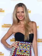 Petra Nemcova attended the Sports Illustrated Swimsuit Issue 50th anniversary bash wearing her hair in an edgy center-parted style.