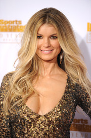 Marisa Miller was sexily coiffed with flowing waves when she attended the Sports Illustrated Swimsuit Issue 50th anniversary bash.
