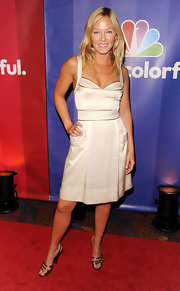 Kelli Giddish looked downright luminous in this gold and white satin cocktail dress.