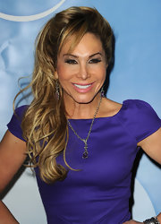 Adrienne Maloof achieved an ultra-feminine romantic look with this side-swept curly 'do at the 2011 Winter TCA Press Tour.