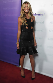 Elle MacPherson showed off her svelte figure in a cutout dress paired with chic black pumps.