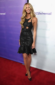 Elle MacPherson wore a black metallic cutout bandage dress for the TCA All-Star Party.