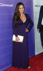 Tia Carrere looked elegant at the All-Star Party in a deep-plunging purple gown.