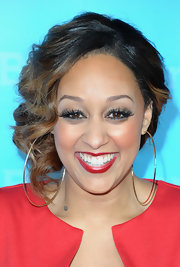 Tia Mowry looked lovely at the NBC Universal 2012 Winter TCA Press Tour wearing her hair in a simple bobby-pinned updo with pretty side-swept curls.