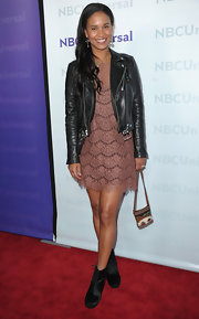 Joy Bryant wore a lacy mauve cocktail dress under her moto-chic jacket at the All-Star Party.