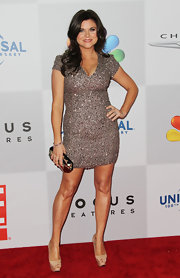 Tiffani topped off her sequined mini dress with nude platform peep-toe pumps.