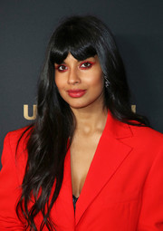 Jameela Jamil stuck to her signature long waves with parted bangs at the NBC and Universal Emmy nominee celebration.
