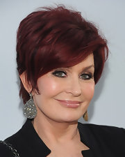 Sharon Osbourne posed at the NBC Universal TCA 2011 Press Tour All-Star Party wearing a pair of clustered diamond earrings.