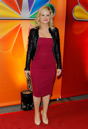 Amy Poehler brightened up the red carpet of the NBC Upfront presentation in this cranberry dress and leather jacket.