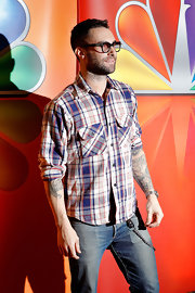 Adam Levine showed off his tats in this plaid shirt with rolled-up sleeves at the NBC Upfront presentation.