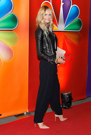 Elle MacPherson sported a pair of slouchy pinstripe pants with her leather jacket for the NBC Upfront presentation.