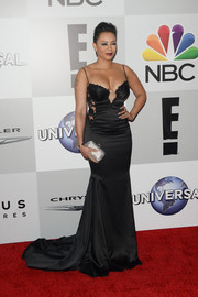 Melanie Brown paired her gown with a glamorous silver clutch.
