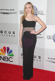 Peyton List went for sultry elegance in a dark-plum one-shoulder gown with a sheer, crystal-studded midsection at the NBCUniversal Golden Globes after-party.