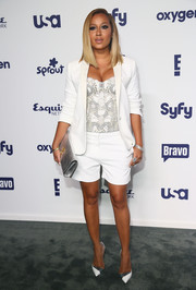 Adrienne Bailon opted for a white short suit teamed with a bustier when she attended the NBCUniversal Cable Entertainment Upfronts.