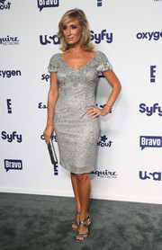 Sonja Morgan kept the shimmer going with a pair of silver cross-strap sandals.