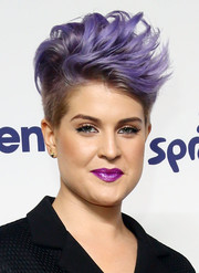 Kelly Osbourne swiped on some berry lipstick for a fun finish to her look.