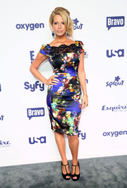 Dina Manzo cut an ultra-feminine figure in a body-con floral and lace frock during the NBCUniversal Cable Entertainment Upfronts.
