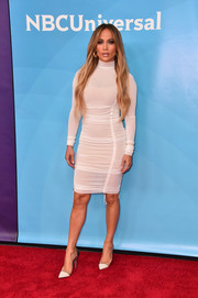 Jennifer Lopez flaunted her ageless figure in a ruched white turtleneck dress by August Getty Atelier at the 2018 NBCUniversal Summer Press Day.