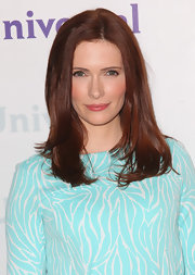 Bitsie Tulloch arrived at NBCUniversal Summer Press Day wearing her shiny auburn locks simply styled.