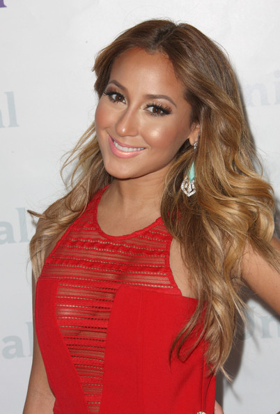 Adrienne Bailon glammed up her look for NBCUniversal Summer Press Day with a pair of long lashes and lots of mascara