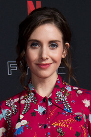 Alison Brie looked romantic wearing this poofy updo with loose tendrils at the Netflix FYSEE event for 'Glow.'