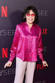Lily Tomlin shimmered in a fuchsia blouse adorned with silver polka dots at the Netflix FYSEE event for 'Grace and Frankie.'