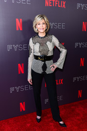 Jane Fonda paired her top with basic black trousers.