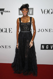 Winnie Harlow donned a black lace corset gown by Dior for the NGV Gala.
