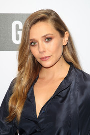 Elizabeth Olsen sported a flowing side-parted hairstyle at the NGV Gala.