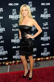 Camille Grammer struck a pose at the NHL Awards in a racy leather mini dress and black keyhole pumps.