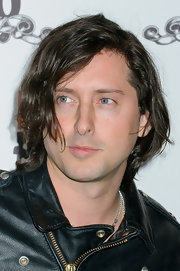 Carl Barat rocked his signature bad boy look with his hair in messy waves.