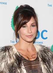 Gina Gershon sported a soft, loose updo with side-swept bangs at the Forces for Nature benefit.