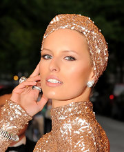 Karolina Kurkova added even more shimmer and shine with a pair of diamond wing earrings in platinum.