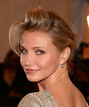 Cameron Diaz added an elegant pair of three carat round brilliant-cut diamond drop earrings set in silver and gold.