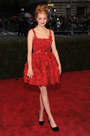 Emma Stone looked ultra-youthful in this red embellished cocktail dress at the Met Gala.