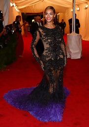 Beyonce stole the show at the Met Gala in this to-die-for sheer beaded and feathered gown with an extravagant train.