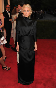 Mary-Kate Olsen loves to wear dark layered looks like this black silk number she designed for herself at the Met Gala.