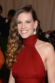 Hilary Swank evoked old Hollywood glamour at the Met Gala with her sexy gown and luxe flowing curls.