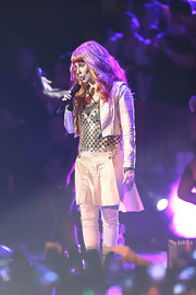 Cher dazzled at the Dance on the Pier party in a gold cropped jacket layered over a metal vest.