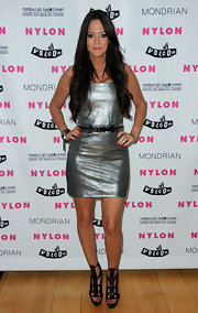 Allison Melnick looked fierce at the 'Nylon' Denim Issue launch in bold black leather cutout sandals. She wore the heavy heels with a fitted silver mini dress.