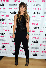 Olivia Wilde looked avant-garde at the Nylon premiere in a sparkling harem jumpsuit and lace ankle boots.