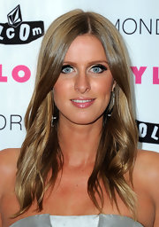 Socialite Nicky Hilton paired her sun-kissed skin and shiny locks with full lashes and glossy lips.