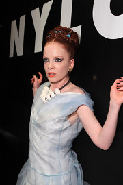 Shirley Manson added a pop of color to her lips with a fashionable bright orange lipstick.