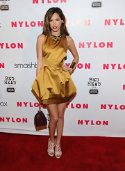 Kelsey Chow strapped on a pair of shiny nude sandals for the 'Nylon' magazine 13th anniversary celebration.