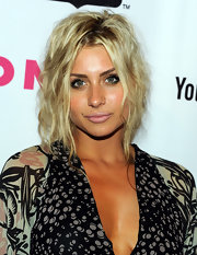 Alyson Michalka walked the red carpet at the NYLON Magazine party with a messy updo full of loose waves.